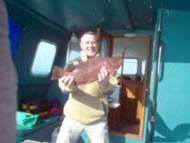 Skipper Dave Bobbett with a Wrasse